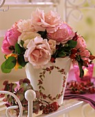 Arrangement of roses with rose hips