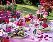 Summery table with roses and fruit