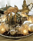 Middle Eastern plate with candles, baubles and glasses