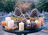 Winter decoration with frost: pine cones, apples, orange slices