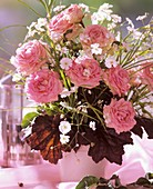 Arrangement of roses, Gypsophila and Heuchera leaves