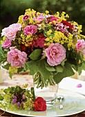 Summer arrangement of roses, lady's mantle & dianthus