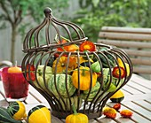 Ornamental gourds, Chinese lanterns & straw flowers in basket