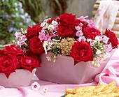 Jardinière with red roses and Phlox