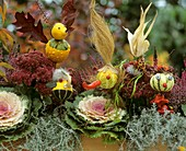 Decorative autumn still life with squash figures