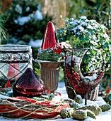 Christmas decoration: windlight, baubles, ivy