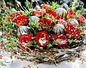Christmas arrangement of red roses, box branches and broom