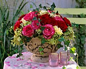 Arrangement of roses, panicle hydrangea and trailing ivy