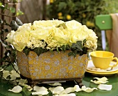 Jardiniere with white roses, hydrangeas and trailing ivy