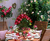 Festive table with roses in open air