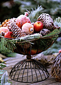 Iron basket with winter decoration