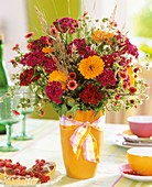 Vase of Sweet Williams, marigolds and Potentilla