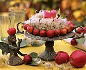 Ornamental apples and Clematis seed heads in an iron bowl