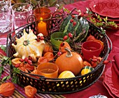 Basket of ornamental gourds, Chinese lanterns, rose hips