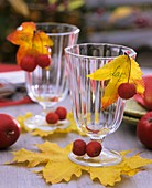 Drinking glasses decorated with ornamental and edible apples