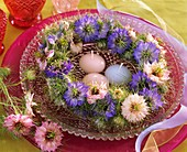 Wreath of Love-in-a-mist with floating candles in a bowl