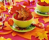 Green bowl with red felt leaf