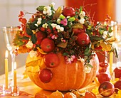 Autumn arrangement in hollowed-out pumpkin