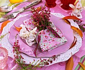 Place setting decorated with heather and china angel