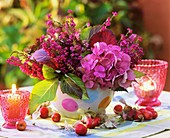 Hydrangeas and erica in vase