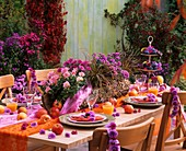 Laid table with flower garlands and apples
