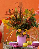 Autumn arrangement in pink vase: Cydonia (quince)