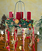 Hanging Advent wreath with red candles and ribbons