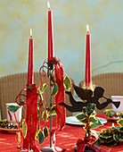 Candlestick decorated with holly leaves and berries