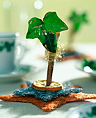 Ivy leaf place-card on a cinnamon stick