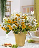 Vase of marguerites, lady's mantle, coreopsis & campanula