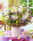 Vase of marguerites and asters