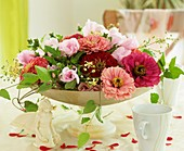 Bowl of zinnias and mallow flowers