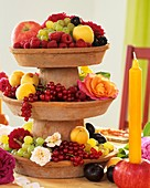 Home-made tiered stand with fruit and flowers