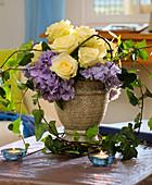 Arrangement of white roses and hydrangeas
