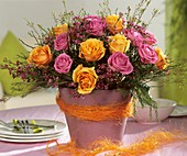 Arrangement of pink and yellow roses