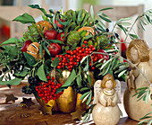 Winter arrangement of rowan, protea, ornamental apples, oranges