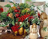 Winter arrangement of rowan, protea, ornamental apples, oranges