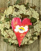 Door wreath of Iceland moss, ivy and red wooden heart