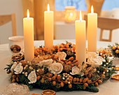 Advent wreath with white candles and dates