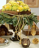 Arrangement of roses with wreath of Noble fir & pine cones