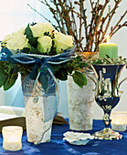 Arrangement of white roses and bay leaves