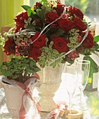 Arrangement of red roses and Pittosporum for wedding