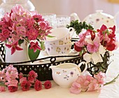 Iron tray with tea things and fragrant posy