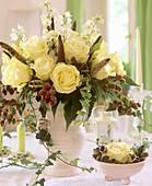 Arrangement of roses, delphiniums and blackberries