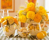 Tagetes with fountain grass and lemons