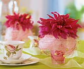 Dahlias in glasses with coloured sisal and pearls