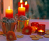 Candle decoration with heather, gerberas & orange slices