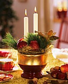 Advent arrangement with apples, twigs and candles