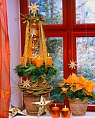 Hanging Advent wreath, poinsettia on window-sill