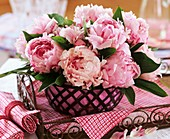 Peonies in metal basket
